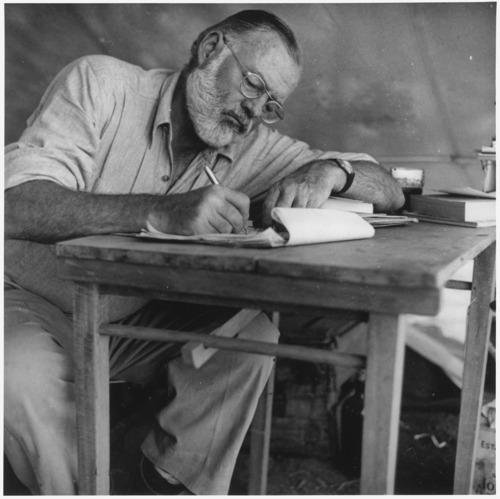 Ernest_Hemingway_Writing_at_Campsite_in_Kenya_-_NARA_-_192655-thumb-500x499-3662