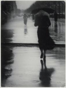 Brassai, Passerby in the Rain